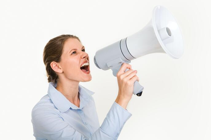 young-woman-with-a-megaphone-3851253